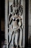 Asparas和devatas,石雕刻吴哥窟 免版税库存照片