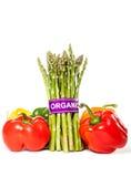 Aspargo e pimentas de Bell saudáveis com etiqueta orgânica Imagens de Stock