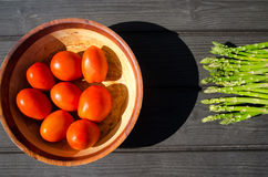 Aspargus and tomatoes. Aspargus and tomatos food raw delicious fresh and natural Stock Photography