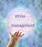 Aspects of Stress Management word bubble. A hand held out open with a red to blue graduated circular world cloud containing words relevant to stress management Stock Image