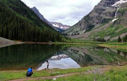 A couple taking pictures at scenic landscape of Maroon Bells stock photo