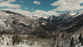 Drone shot of scenic landscape of the rocky mountains, forests and snowy back roads near Aspen Colorado stock video