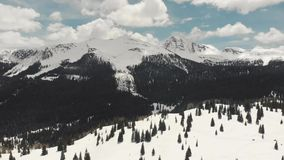 Drone shot of scenic landscape of the rocky mountains, forests and snowy back roads near Aspen Colorado stock video footage