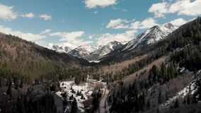 Drone shot of scenic landscape of the rocky mountains, forests and snowy back roads near Aspen Colorado