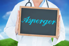 Asperger against green hill under blue sky Royalty Free Stock Photography