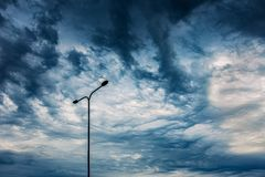 Asperitas cloud formation with the lamp, dramatic image stock photography