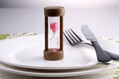 Aspettando la cena Immagini Stock
