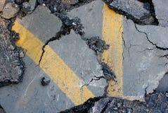 Asphalt. Cracked surface of an asphalt road Stock Image