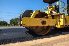 An asphalt roller. On asphalt asphalt rider there an asphalt roller to keep everything well pressed Stock Image