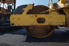 An asphalt roller. On asphalt asphalt rider there an asphalt roller to keep everything well pressed Stock Images