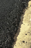 Asphalt and asphalting the road Royalty Free Stock Images