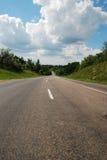 Asphalt auto road in summer. Green landscape of Ukraine Stock Images