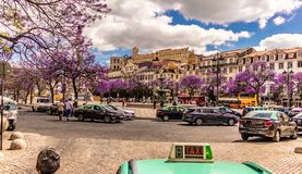 --view of rossio square Lisbon portugal date-20 may 2019 with beautiful blue sky with clouds and beautiful blooming trees. royalty free stock photo