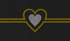 Asphalt background with painted heart Royalty Free Stock Image