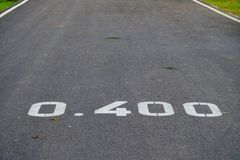 Close up park road with the distance number on the pavement for a runner information royalty free stock photography