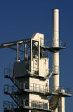 Asphalt batching plant. View at brand new asphalt batching plant on a blue sky royalty free stock photo