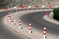 Asphalt bend and metal posts. In Polish city - Warsaw Stock Photos