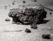 Asphalt blocks on the road. Old asphalt road debris piling up on the ground stock photography