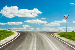 Asphalt Broad Road With Blue Sky. Asphalt Road With Blue Sky In Sunny Day Stock Photo
