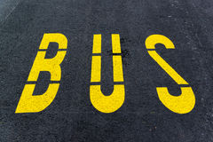 Asphalt bus station sign Stock Photos