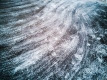 Asphalt cleared from snow. Texture. stripes from snowstrike broomstick. First snow falls in city. winter.  stock image
