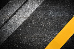 Asphalt. Close up old top view of asphalt road with separation lines Royalty Free Stock Images