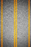 Asphalt concrete road texture as background. Two lanes and two directions road. Yellow line separate two lanes - forward and backward Stock Images