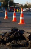 Asphalt Construction and Safety Cones. On road Royalty Free Stock Photos