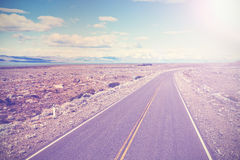 Asphalt country road with back light Stock Photography