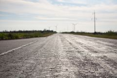 Asphalt of country road in backlit Stock Photos