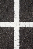 Asphalt with cross white line Royalty Free Stock Photography