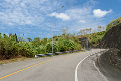 Asphalt curve road with lighting pole Stock Image