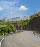 Asphalt curve road with lighting pole Royalty Free Stock Photo
