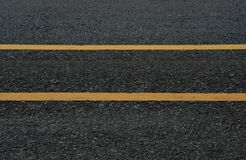 Asphalt dark texture with double yellow lines Stock Photography