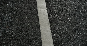 Asphalt dark texture with white lines Stock Images