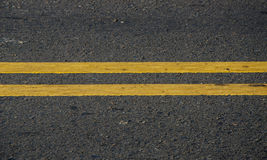Asphalt dark texture with yellow lines Royalty Free Stock Photography