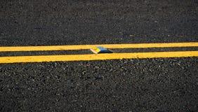 Asphalt dark texture with yellow lines Stock Photo