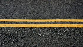 Asphalt dark texture with yellow lines Stock Photography