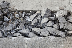 Asphalt demolishing, heap of broken asphalt Stock Photo