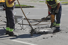 Asphalt demolishing, worker and jackhammer Royalty Free Stock Images