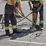 Asphalt demolishing, worker and jackhammer Royalty Free Stock Image