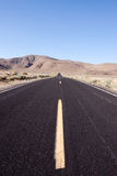 Asphalt desert road Royalty Free Stock Images