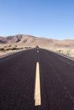Asphalt desert road. Desert road in the southwestern United States Royalty Free Stock Images