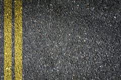 Asphalt. Double Yellow Sign on Asphalt Stock Images