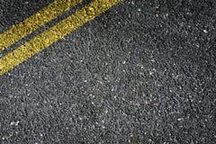 Asphalt. Double Yellow Sign on Asphalt Stock Photography