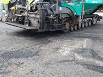 Asphalt Driveway parkeringsplatsreparation Arkivbild