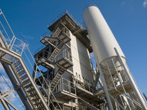 Asphalt Factory. Asphalt-factory with production-tower and silo and blue sky in background Stock Photography