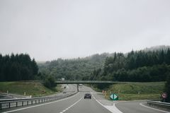Car on highway with forest on background Royalty Free Stock Photo