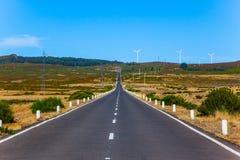 Asphalt highway crosses the island Royalty Free Stock Photos
