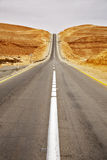 Asphalt highway in desert Stock Photos